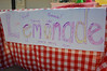 """Ainsley finally go to run her lemonade stand today.  I wrote the """"fresh"""" and """"homemade"""" comments on the sign, but she decided that wasn't quite enough.  She added """"isee"""" (icy), """"Yumee"""" (Yummy), """"cool"""" (self-explanatory), """"osum"""" (awesome), and """"Grandpa uproovd! (Grandpa approved)."""