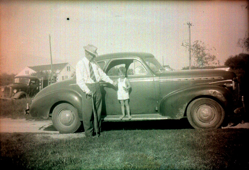 W.C. with my brother, Steve, in Sinton, 1943, roughly...1940 Chevy.. a little banged up...