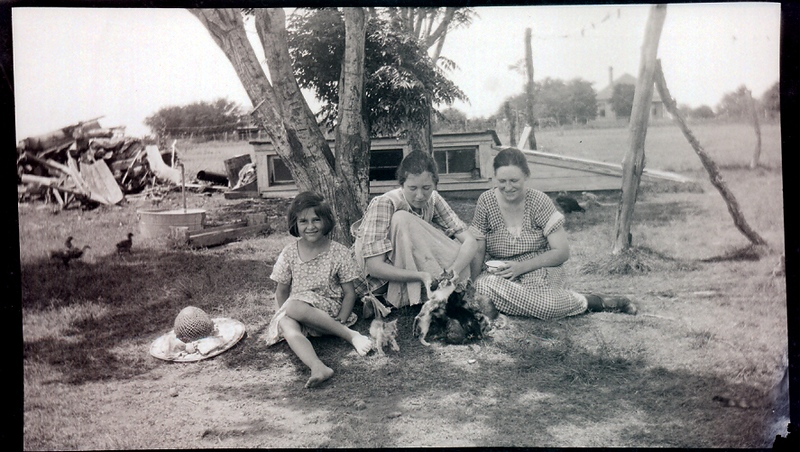 Mom and her two big sisters, Winifred Cecelia and Marian Agnes playing with some kittens.