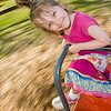 beautiful smiling girl rides a merry-go-round in motion  <i>All images - unless otherwise indicated - Copyright © 2007-2008 Andrew Lundquist, all rights reserved. The ability to download pictures from these galleries, where enabled and regardless of size, does not grant or imply any license or permission to use for any purpose other than personal viewing.</i>