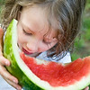 little girl finishes huge slice of watermelon