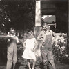 Backyard of the Johnson house, Hastings, NE <br /> July 4, 1930 <br /> On the right: Edward G. Johnson <br /> Center: Eileen Masters. <br /> On the left: Alvin F. Johnson Sr.