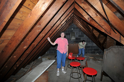 carol in the attic above the garage where they played in the summertime