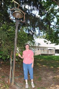 carol ringing the bell