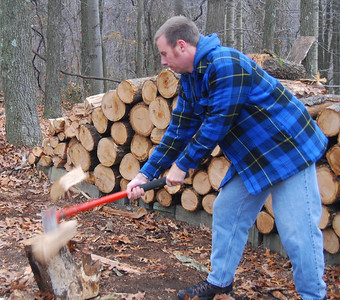 David demonstrates how to split wood properly