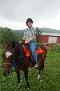 Riding horses at Joann and Mike's Farm