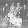 Blimtcha Lipmanovich (my aunt) tallest in center. Seated: Devorah Lipmanovich holding her daughter Hadasa. To her right is Yedidyah (Dan) Lipmanovich. Above him is his mother. Other girls are Dan's other sisters.