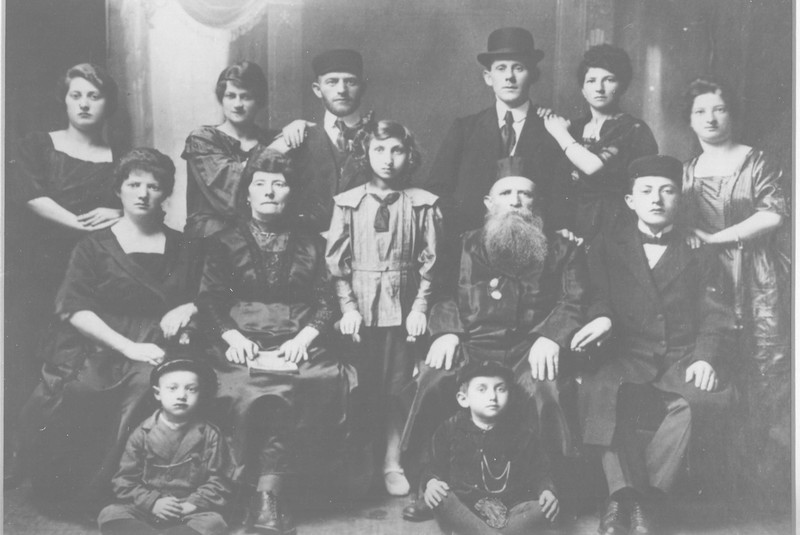 Top Row:L to R, Bella Garcash, Chaya Brandzel, Yossel B., Getzel B., Gittle B., Rachel Weinbaum. Bottom Row on chairs: Rifka Fleishman, Chana Ray Brandzel,Rachel Fleishman,Yaakov Brandzel,Harold Brandzel. Seated on floor: Moshe Brandzel, Avraham Fleishman. Lodz 1920