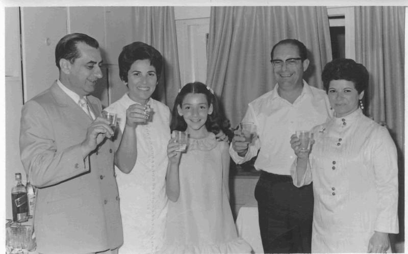 l. to r.: Dan Lipman, Hadasah Ben-Itto, Orli Ben-Itto, Gershon Ben-Itto, Regina Lipman. Toasting Orli's bar mitzvah, 1976.