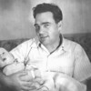 Fred Yashon, husband of Ruchel Yashon (my mother's first cousin), holding his son Jerry. Toronto, 1957.