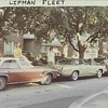 Rita Lipman (left) and friends, perched on the Lipman's 3 Oldsmobile Cutlasses, Chicago, August 1973