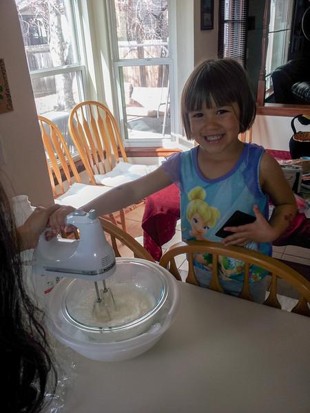 Elena helping Mommy bake