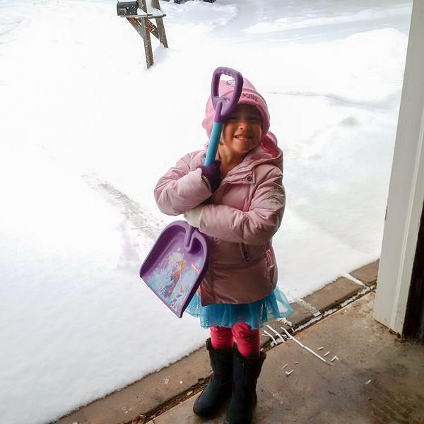 Elena ready to help shovel snow with her new snow shovel