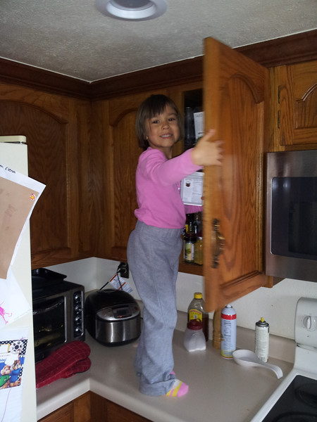 Elena climbed up to get the hot chocolate after playing outside in the snow