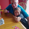 Elena and Grandpa having a tea party