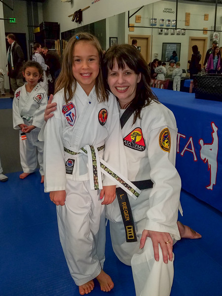 Elena earned her next TKD belt (Camo)