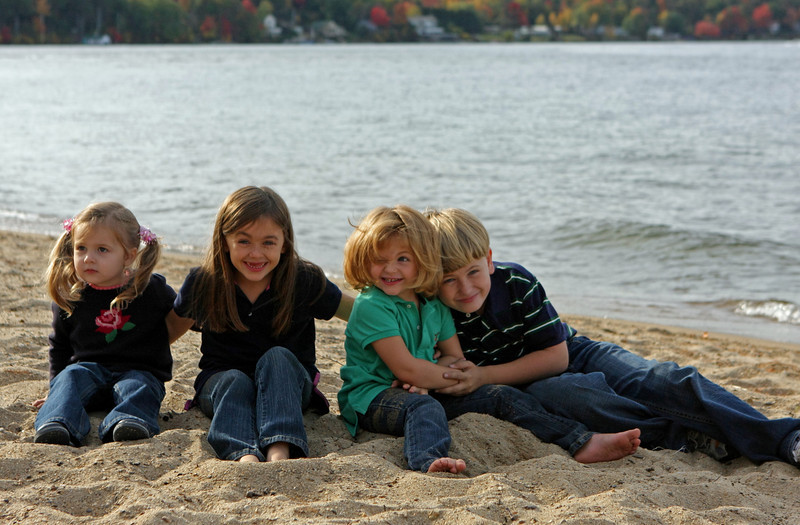 October 12, 2008... I did some family shots at the lake this weekend.  It was tough trying to find the right spot (it was very bright) and these little cuties just love to play! It was so hard to get them all to look at me.  This one was one of favorites!