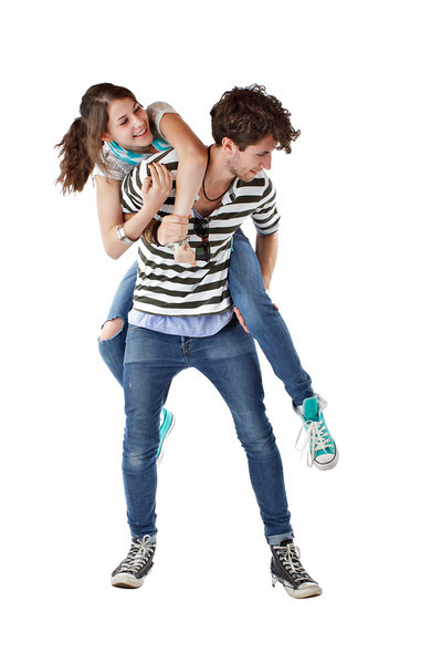 Laughing playful teen couple