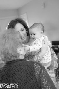Mrs. Calabrese greeting her great -grandbaby, Elle. Who had her christening the day before.