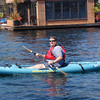 Bill with a big smile after his paddle board turned into a kayak