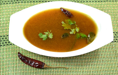 Rasam is a south indian tradiotional soup. It is eaten with rice or separately as a spicy soup.