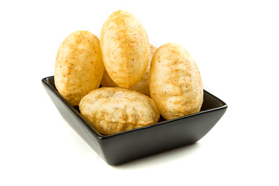 Puffed fried puri isolated on a white background isolated on a white background