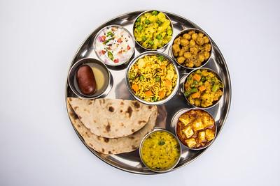 indian food platter, indian thali, indian veg thali,paratha, rice, aalu bhaji,puri or poori, complete meal, south indian thali