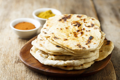 Indian naan bread on wooden desk
