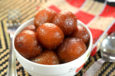 Gulab Jamun is an Indian dessert made out of condensed milk balls and sugar. They are fried and soaked in sugar syrup. It is a popular Indian sweet dish prepared during Indian festival Diwali,