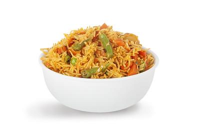 indian vegetable biryani served in white bowl