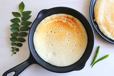 Soft & Spongy Malvani Amboli. It is a typical Konkani preparation made with rice and Urad dal or black lentil  fermented batter. Soft Dosa or plain uttapam. Best to combine with fish curry. Copy Space