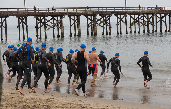 The second wave of swimmers heading out