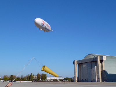 The Airship Ventures Zeppelin being led home by it's high-tech windsock wielding ground crew.
