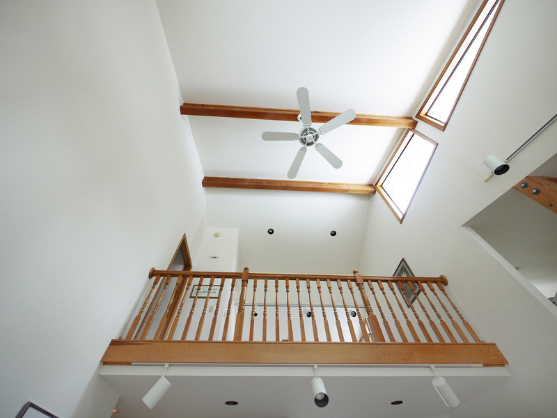 Looking up to the high ceiling from the sunken living room.