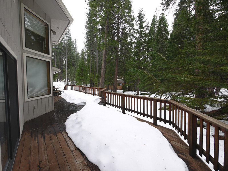 The back deck, with Placer Way on the left, and a small occasional-use home down the hill a bit.
