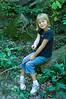 Lauren sitting on log vertical
