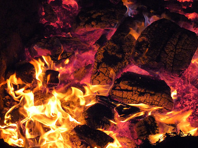 The hot coals resemble Tiki gods and skulls.