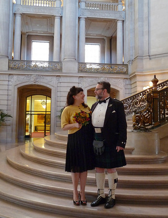 The soon-to-be-weds on the stairs