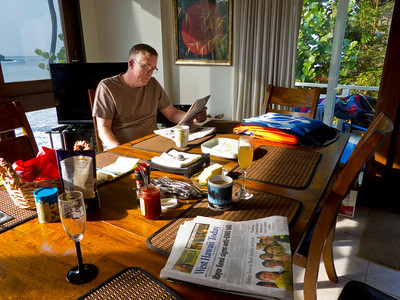 Alan reads about the 20 degree temperatures in California as we enjoy the 75 degree morning...