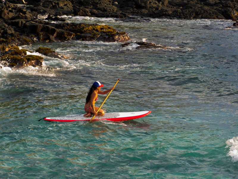 Lovely paddle boarder taking ff from the small beach right below our house.