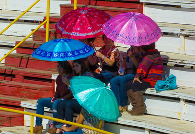 """Ladies staying cool while waiting for the bullfights to start at the annual Portuguese """"Our Lady of Fatima"""" Celebration in Thorton, CA."""