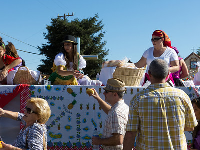 "Handing out bread and milk to the crowd at the annual Portuguese ""Our Lady of Fatima"" Celebration parade in Thorton, CA."