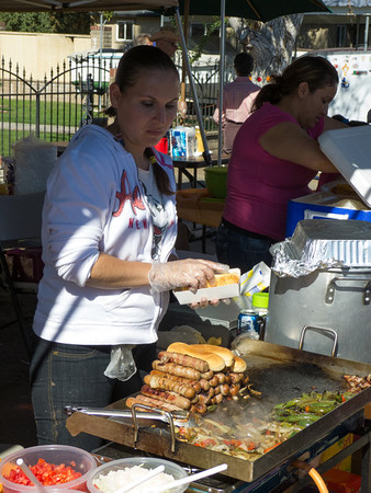 """Bacon wrapped linguica sausage with onions and peppers at the annual Portuguese """"Our Lady of Fatima"""" Celebration in Thorton, CA."""