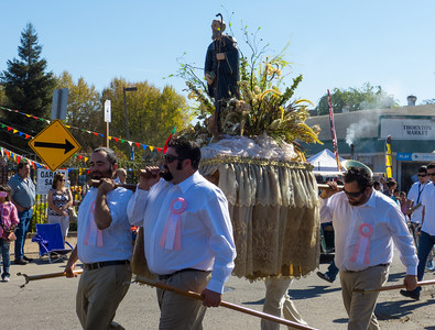 """A saint being carried in the annual Portuguese """"Our Lady of Fatima"""" Celebration parade in Thorton, CA."""