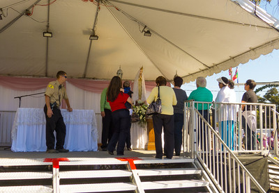 """People pay their respects at the annual Portuguese """"Our Lady of Fatima"""" Celebration in Thorton, CA."""