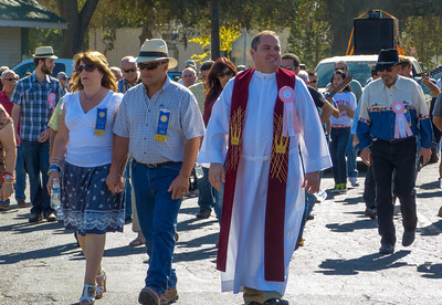 """The priest arrives in the annual Portuguese """"Our Lady of Fatima"""" Celebration parade in Thorton, CA."""