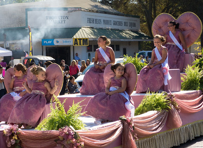 "A float of Ladies in Very Relaxed Waiting in  the annual Portuguese ""Our Lady of Fatima"" Celebration parade in Thorton, CA."