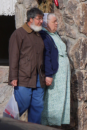 Cute old timey couple holding hands in Jackson, CA