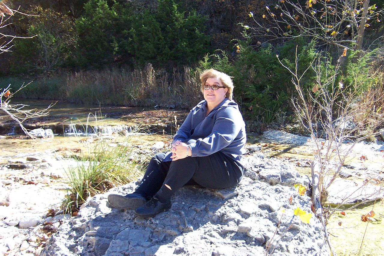 Wendy enjoys the chilly November sunshine at Lost Maples State Park.
