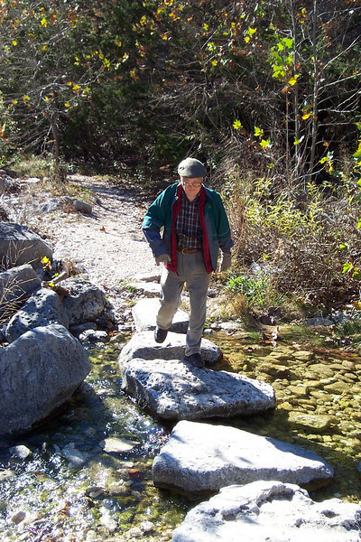 Dad negotiates the stepping stones over the creek at Lost Maples State Park.